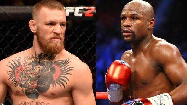 MMA president Dana White says he anticipates that Mayweather, right, will earn US$100 million  from the bout, and ...