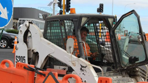 A worker at the corner of Edmonton Rd and Te Atatu Rd in Auckland.