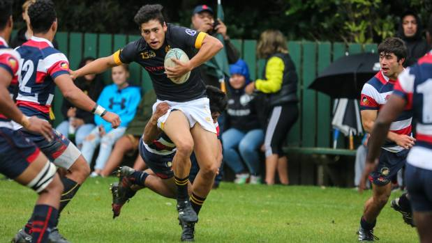 Wellington College rugby player Josh Morgan Ranui tries to evade a Hastings Boys' High School tackler on April 29.