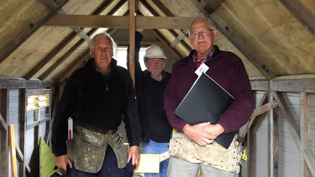 Waikanae Menzshed members from left, Murray Cardie, Paul Fitzgerald and Dave Porter inside the hut they have restored.