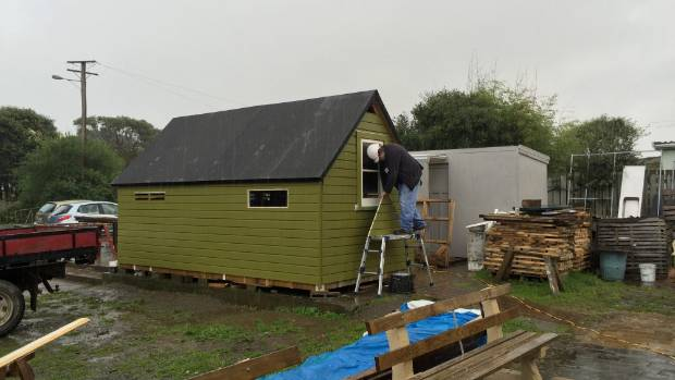 Paul Fitzgerald works on restoring a 1940s American Marine hut at the Menzshed base in Waikanae.