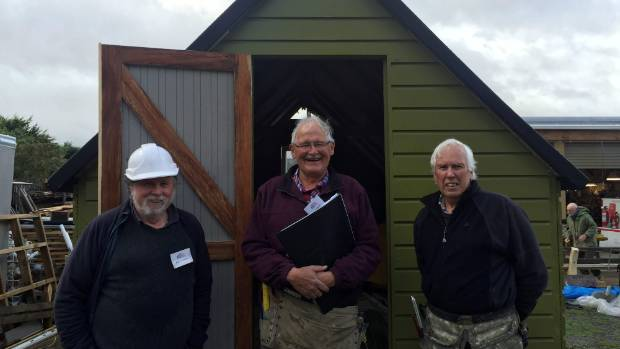 Waikanae Menzshed members from left, Paul Fitzgerald,  Dave Porter and Murray Cardie outside the hut they have restored.