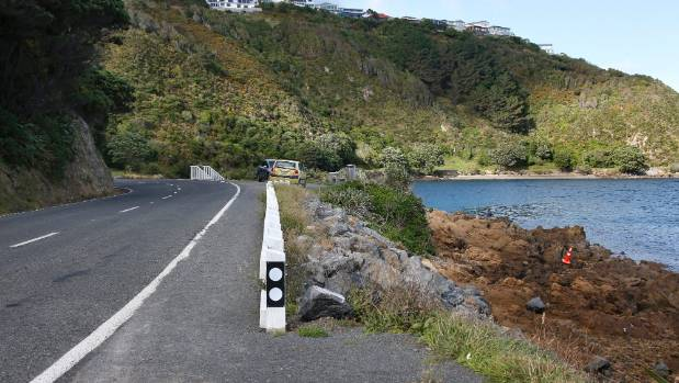 Shelly Bay Rd is currently 6 metres wide. The position of the orange road cone shows how wide it would be if it became ...