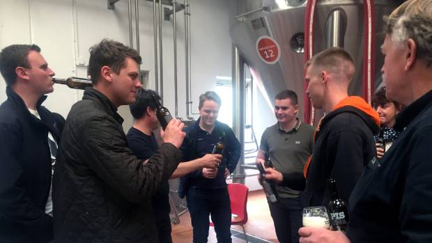 Visitors taste Pisner beer. It does not contain any human waste but is produced from malting barley fertilised with urine.