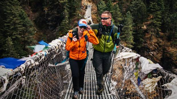 The couple cross bridges as they make their way to Namche Bazaar.