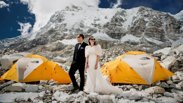 Ashley and James pose outisde the tents they slept in.