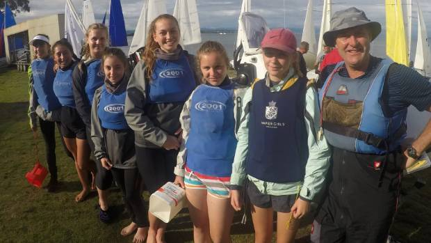 The teams racing sailing group from Napier Girls' High School with co-coach Nigel Mannering.