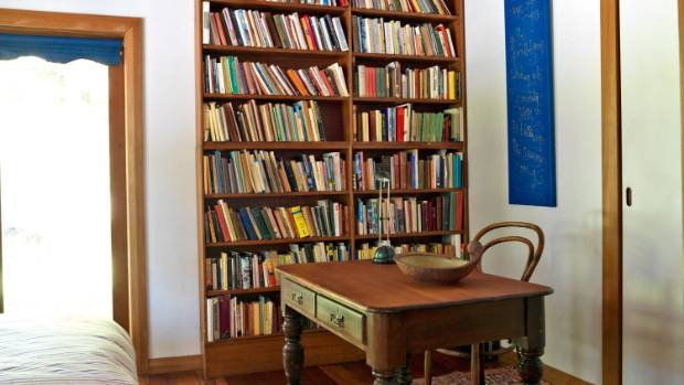 A spare bedroom complete with built-in bookcase.