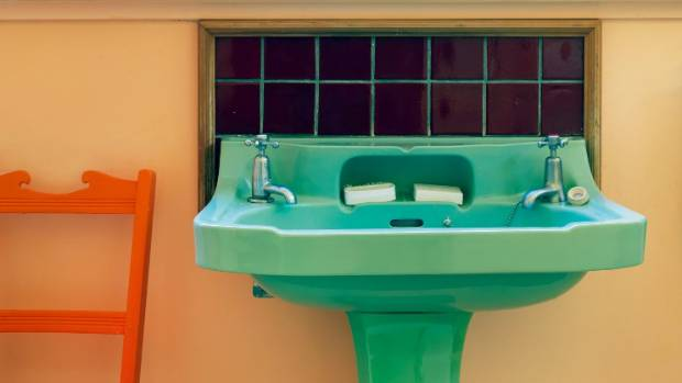 The bright green sink in the downstairs bathroom is an original Royal Doulton pedestal basin that Rhondda installed 40 ...