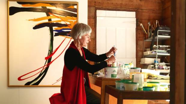 The artist in her light-filled studio, a short stroll across a shingle path from the main house; the painting behind her ...