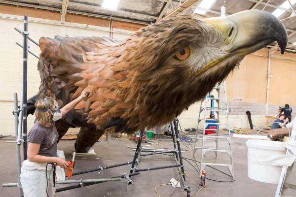 Weta Workshop artist creates the eagle for Wellington airport.