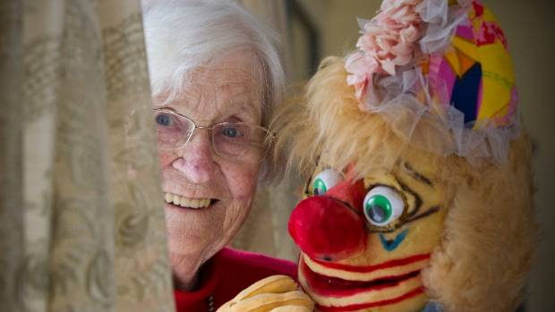 Lower Hutt singer, writer, puppeteer and all-round entertainer Franki Wood with one of her hand-made puppets.