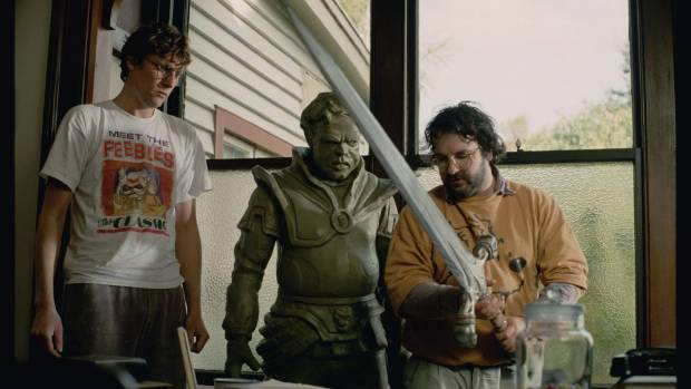 Special effects whiz Richard Taylor (left) and director Peter Jackson checking out props for Heavenly Creatures. The ...