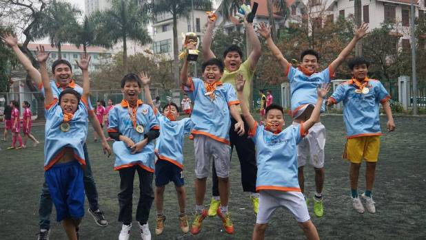 Blue Dragon Children's Foundation has played more than 2200 games of soccer. Pictured are its gaelic football champions.