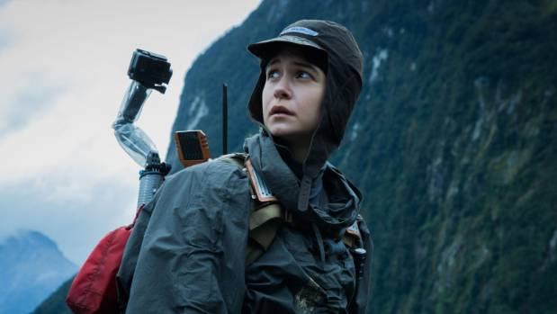 Alien: Covenant star Katherine Waterston is dwarfed by the Fiordland landscape.