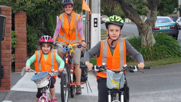 Cycling enthusiast Jo Clendon, with her children Kiri 6, and Max, 9.  She has petitioned Parliament for a law change ...