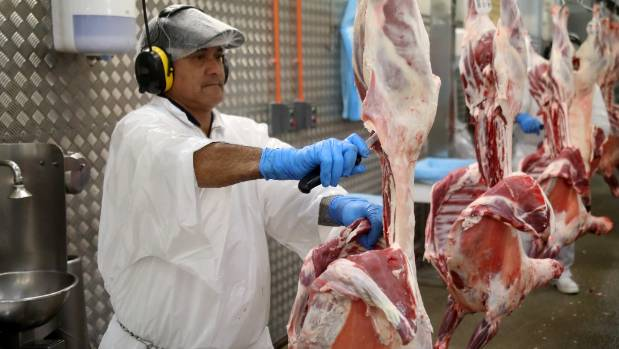 A worker processes lamb for export to Iran at the Taylor Preston plant in Wellington.