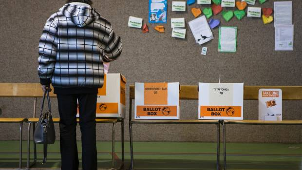 A woman casts her vote at Christchurch East School during the 2014 election. A vote once every three years is an ...