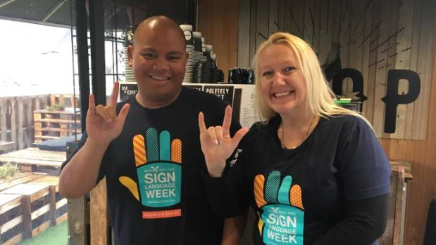 Joe Tusa (L) and Natasha Cloete are both deaf, and supporting Sign Language Week in New Zealand.