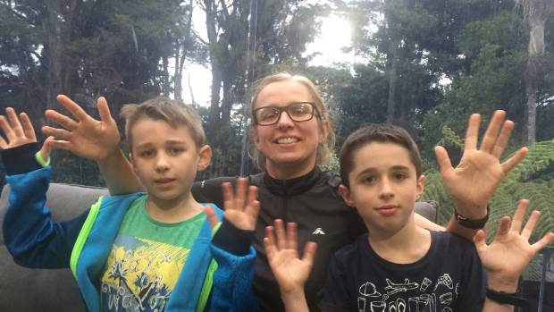 Monica Leach who is deaf with sons Oliver Leach, 10, (left) and Jack Leach, 8. The boys' first language is New Zealand ...
