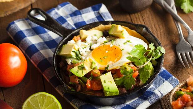 Huevos Rancheros is a hearty dish of fried eggs, corn tortills and a rich tomato stew.