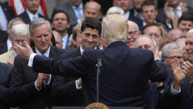 US President Donald Trump about to hug malevolent House Speaker Paul Ryan, after the House of Representatives approved ...