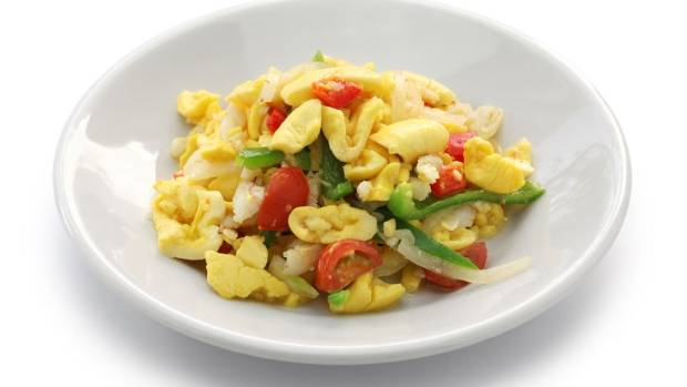 Ackee and saltfish is a popular Jamaican dish. Ackee is a fruit that has a texture like scrambled eggs when cooked.