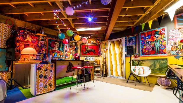 The brightly coloured spaces boasts a retro-bar, a speaker system and a pool table.