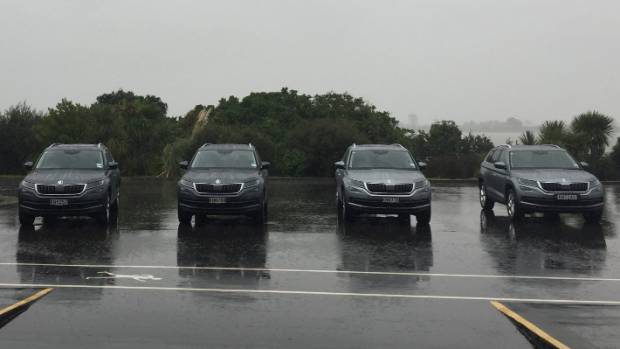 The Kodiaq lineup in the Auckland rain - Ambition, Ambition+ and a pair of Styles.