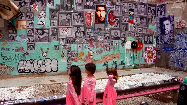 This photo taken in El Born, a bohemian district of Gothic Barcelona, shows three young Spanish sisters obviously ...
