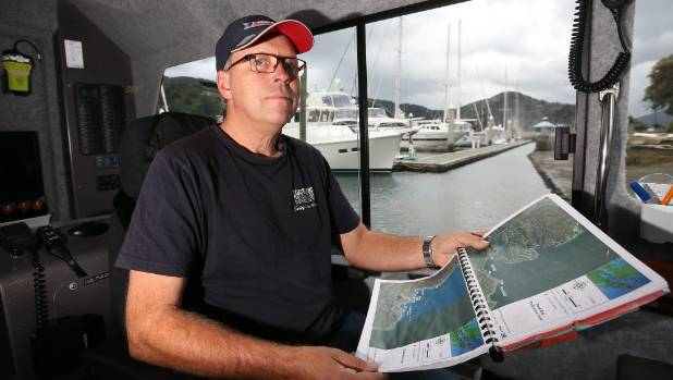 Coastguard Marlborough operations officer David St John at the helm of the boat, looking over jetty locations in the ...