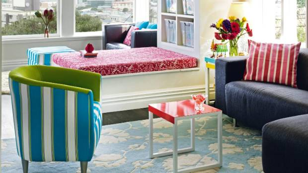 Stripes and florals effortlessly combine as the red and blue link the two; the scale of the patterns has also been ...