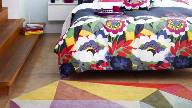 Being adventurous with patterns has paid off in this bedroom with fearlessly bright florals working well with the large ...