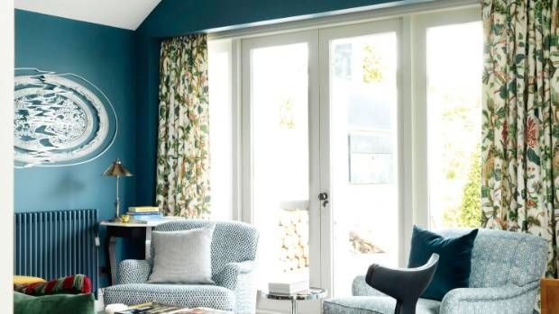 Soothing blues and greens unite several patterns in this room.