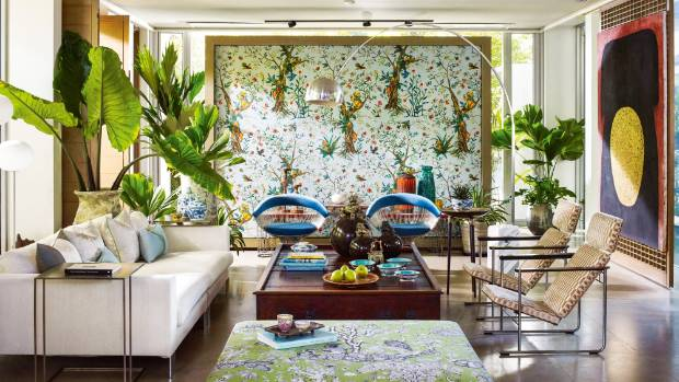 In this room, patterned fabrics are counterbalanced by large blocks of neutrals.