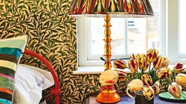 A tightly coordinated colour scheme pulls the patterns together in this bedroom.