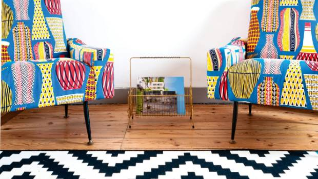 Let the eye rest: vivid patterned armchairs sit well against a calm white wall.