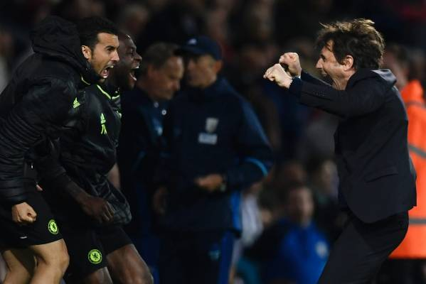 Chelsea manager Antonio Conte, Pedro and Victor Moses celebrate winning the English Premier League title.