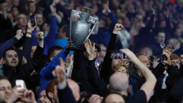 Chelsea fans celebrate with a replica English Premier League trophy after Michy Batshuayi  scores a goal against West ...