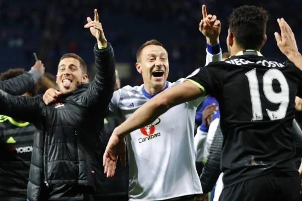 Chelsea's Eden Hazard, John Terry and  Diego Costa celebrate winning English Premier League.