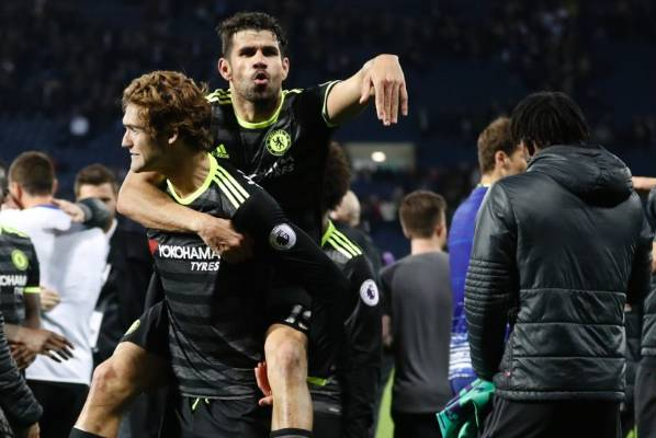 Chelsea's Marcos Alonso and Diego Costa celebrate winning the English Premier League title.