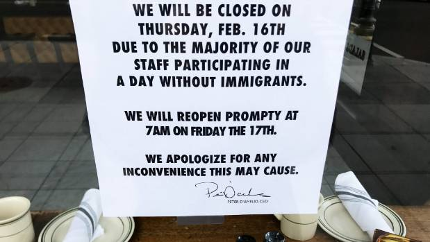 "A window of a Washington DC restaurant explaining its closure during the ""Day Without Immigrants"" protest in February."