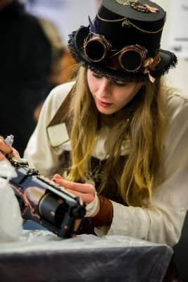 Alisha Harrop, aka Ms Violet Coppersmith, decorates a steam punk gun.