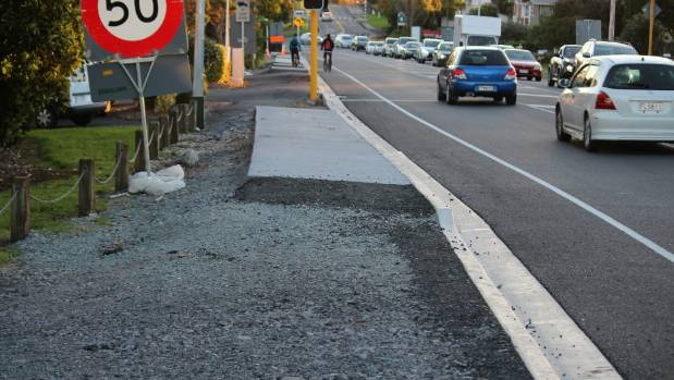 The footpath in front of Te Atatu Community Centre. One cyclist could be seen avoiding the footpath on Edmonton Rd.