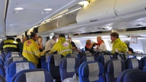 Paramedics assess injured passengers after QF72's emergency landing at a West Australian RAAF base.