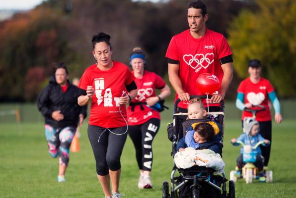 Shonalla Tangaere runs while seven months pregnant, with Sonny Woodmass, Waimaria Woodmass, 3, and Cairo Woodmass, ...