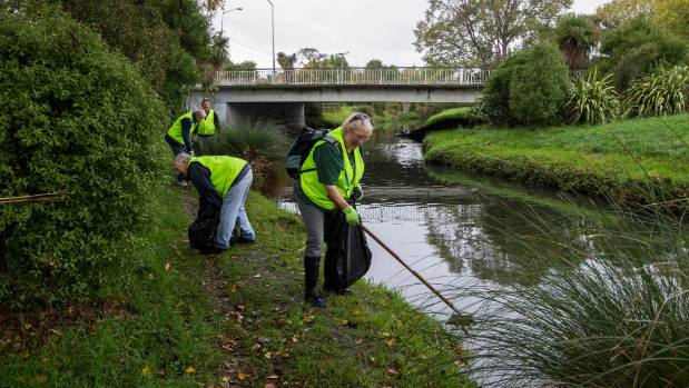 Gordon McKay, Gerry Ballantine, Bernie Kenny and Kris Wilson, from the Christchurch South Lions Club, pick up rubbish ...