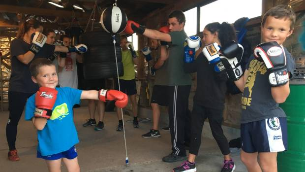 Buster, 4, and Jacob, 8, Ford with Ripeka Manawatu,14, and Kaikoura Boxing Club's star boxer Thomas Harnett-Poharama,19.