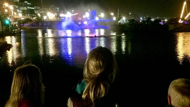 Lily, Ava and Sam Thomas watch a light installation during the LUX Lights Festival.