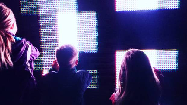 Ava, Sam and Lily Thomas check out the Control No Control installation at the LUX Lights Festival.